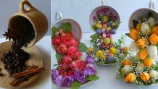 Lebdeće šolje od cveća i zrna kafe.